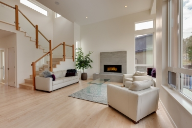 Beautiful home design by Motivo Design Group Inc.  Modern gorgeous living room space with beautiful fireplace as the centrepiece.